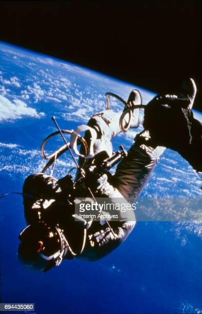 Astronaut Ed White II makes the first space walk during the Gemini 4 mission June 3 1965