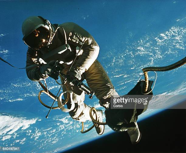 Astronaut Edward H White EVA or spacewalking outside his Gemini rocket In orbit 1965   Location above Earth