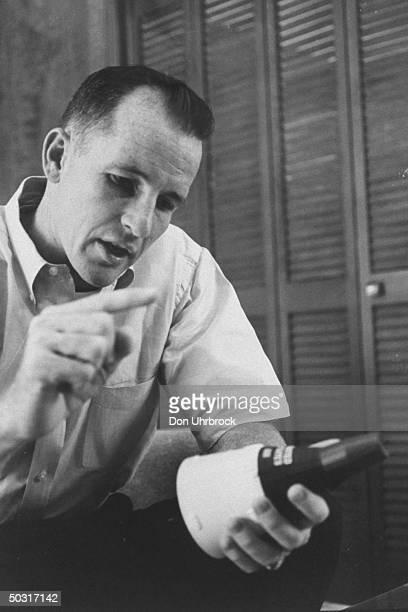 Astronaut Edward H White explaining his experiences aboard Gemini spacecraft