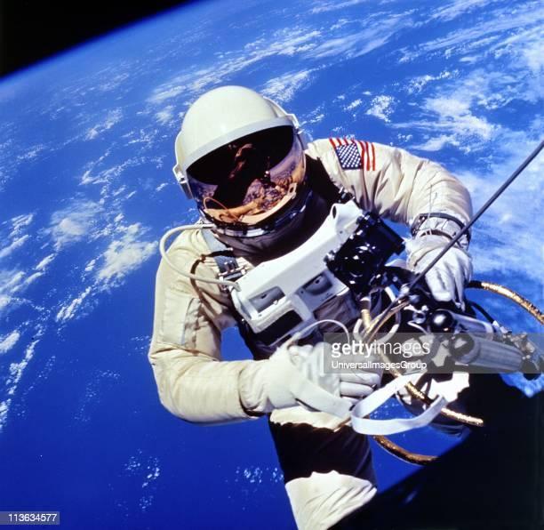 Astronaut Edward H White II carrying out external tasks during third orbit of GeminiTitan 4 flight NASA photograph
