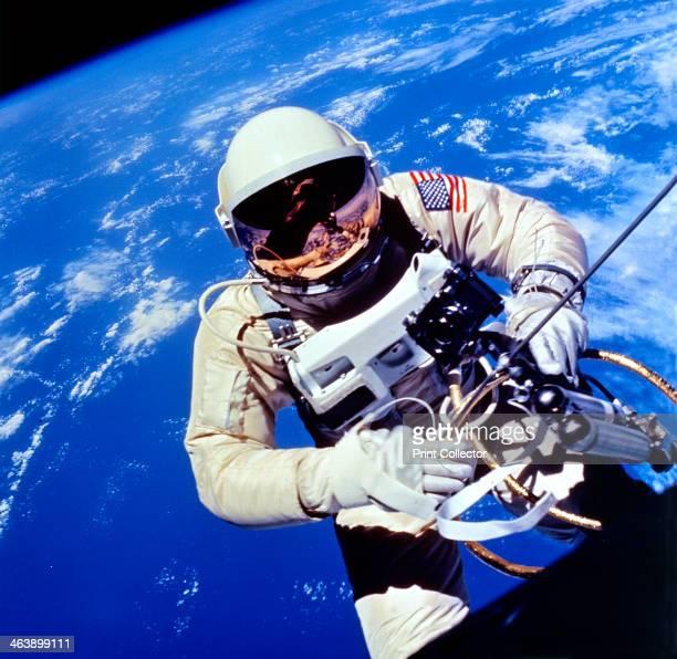 US Astronaut Edward H White II carrying out external tasks during third orbit of GeminiTitan 4 flight CREDIT NASA
