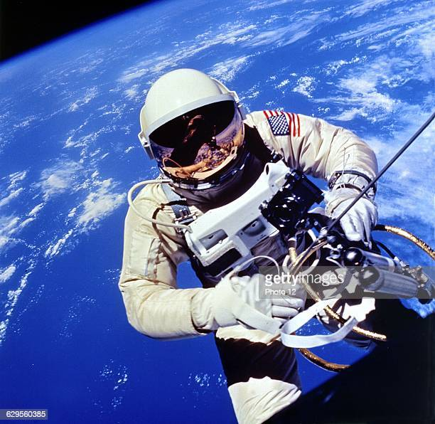 US Astronaut Edward H White II carrying out external tasks during third orbit of GeminiTitan 4 flightNASA Photograph