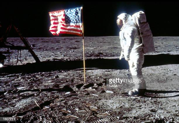 Astronaut Edwin Buzz Aldrin poses next to the US flag July 20 1969 on the moon during the Apollo 11 mission