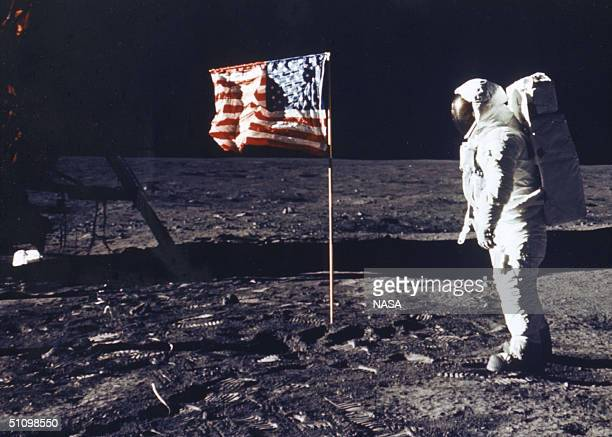 Astronaut Edwin E. Aldrin Jr. Poses For A Photograph Beside The Deployed Flag Of The United States. The Lunar Module Is On The Left. Man's First...