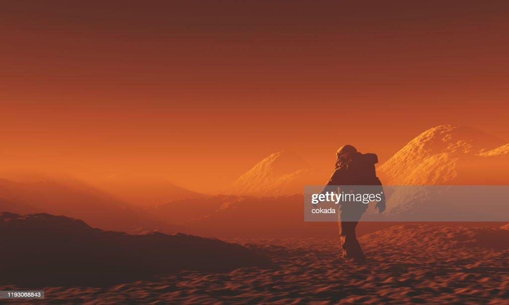 Astronaut exploring Mars : Stock Photo