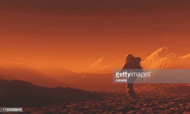 astronaut exploring mars - mars stock pictures, royalty-free photos & images