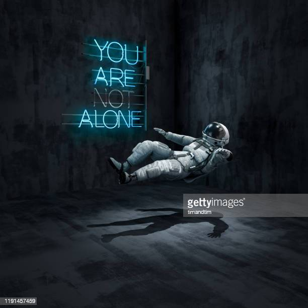 astronaut floating in a room with a neon - in de lucht zwevend stockfoto's en -beelden