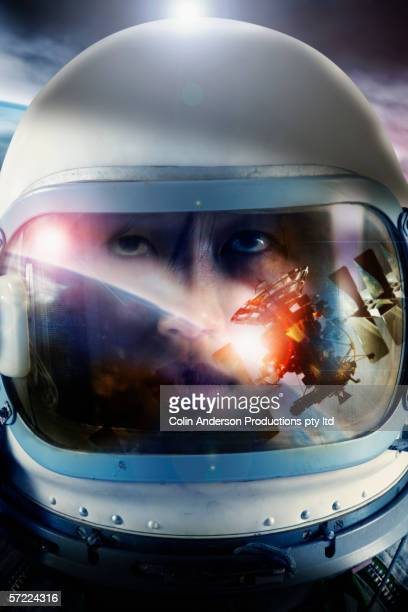astronaut floating in space near satellite - space helmet stock photos and pictures