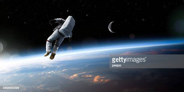 astronaut floating in space - copy space stockfoto's en -beelden