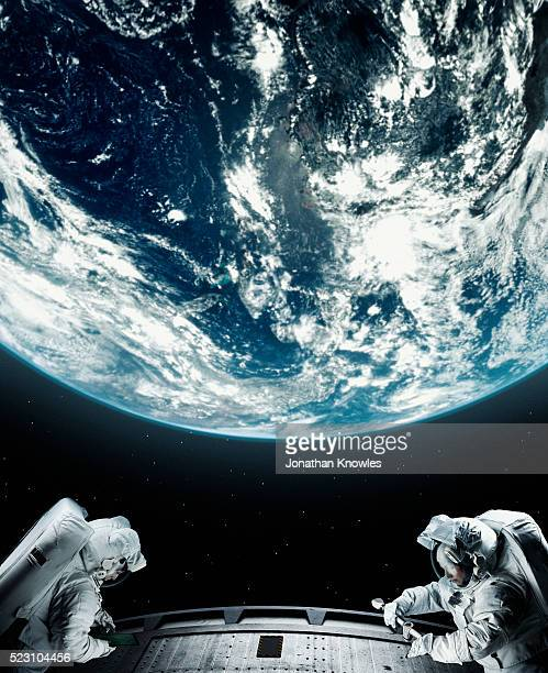 astronaut floating in space - space helmet stock photos and pictures
