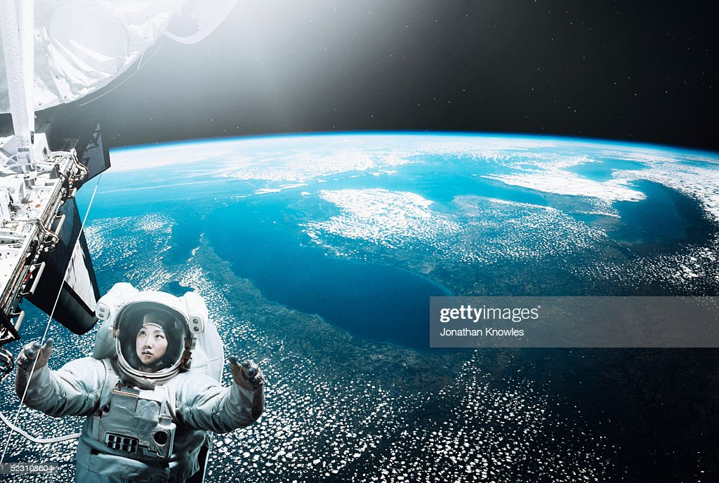 Astronaut floating in space : Stock Photo
