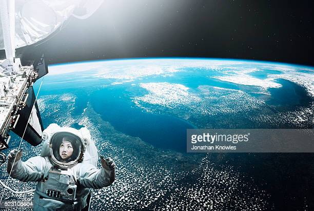astronaut floating in space - space station stock pictures, royalty-free photos & images