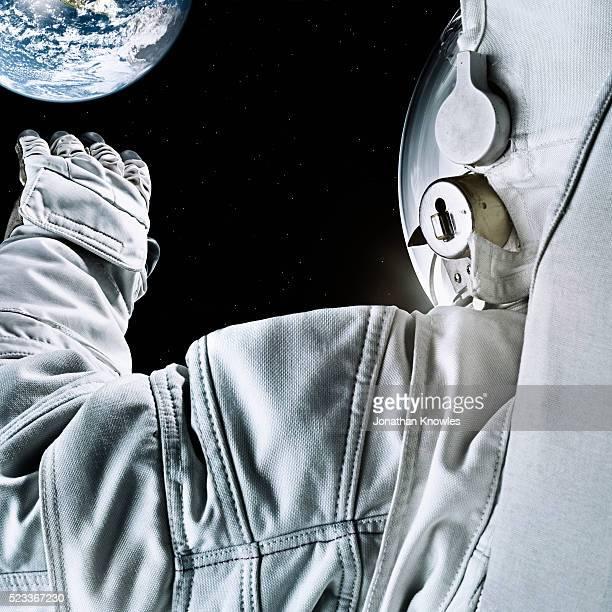 astronaut floating in space - 宇宙探検 ストックフォトと画像