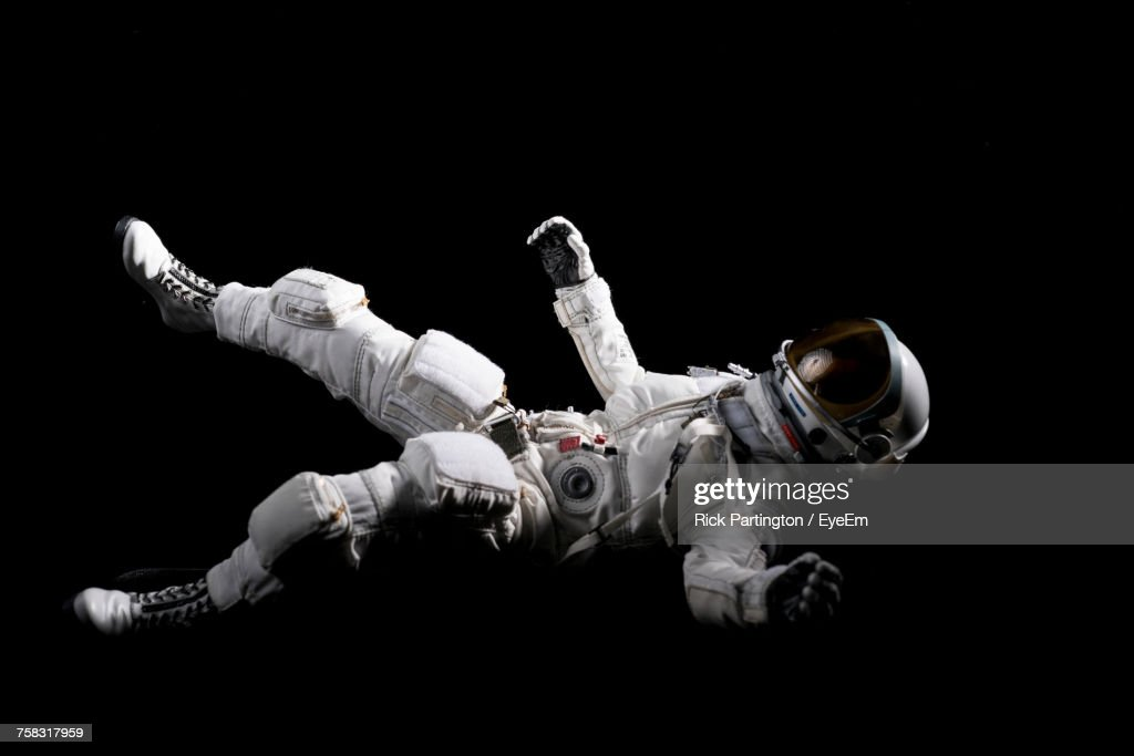 an astronaut floating in space - photo #14