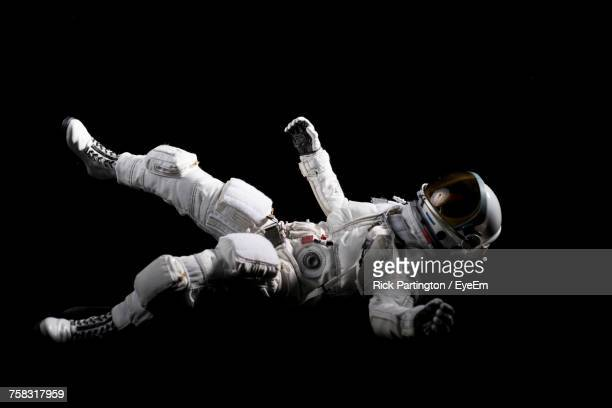astronaut floating in space - astronaut stock-fotos und bilder