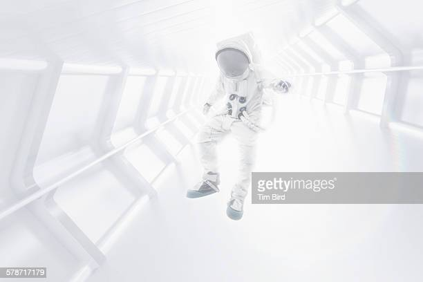 Astronaut floating through tunnel