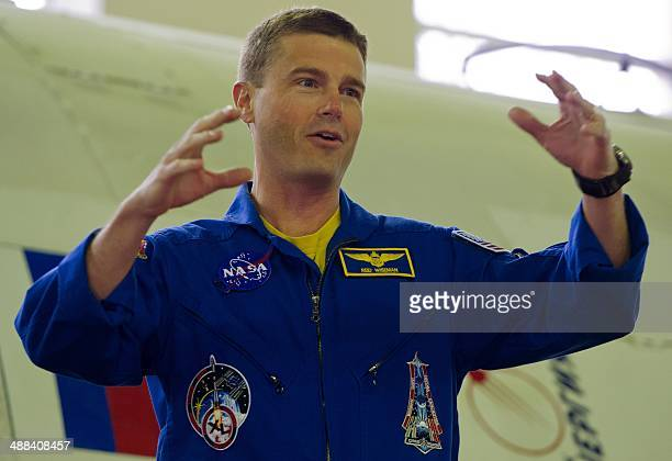 US NASA astronaut Gregory Wiseman a crew member of the 40/41 expedition to the International Space Station gestures as he attends a preflight...