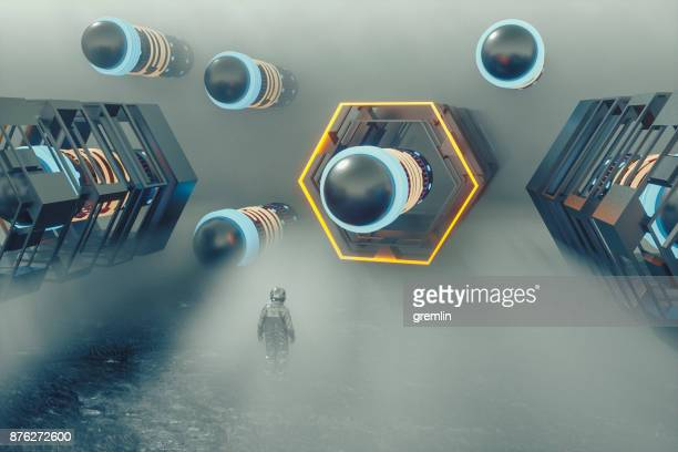astronaut in fog against alien object - extrasolar planet stock pictures, royalty-free photos & images