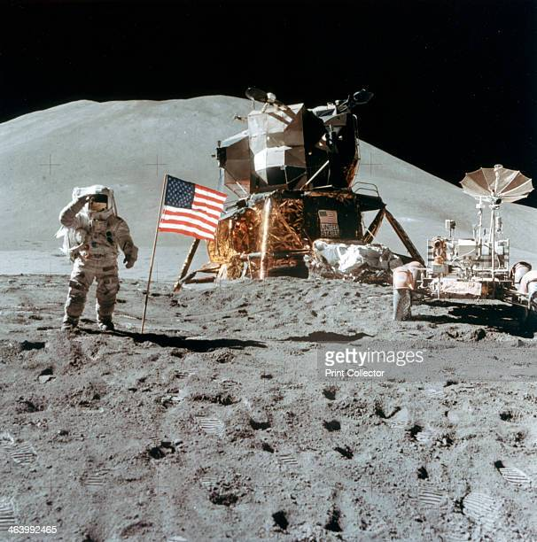 Astronaut James Irwin gives a salute on the Moon 1971 Irwin pilot of the Lunar Module gives a military salute while standing beside the deployed US...