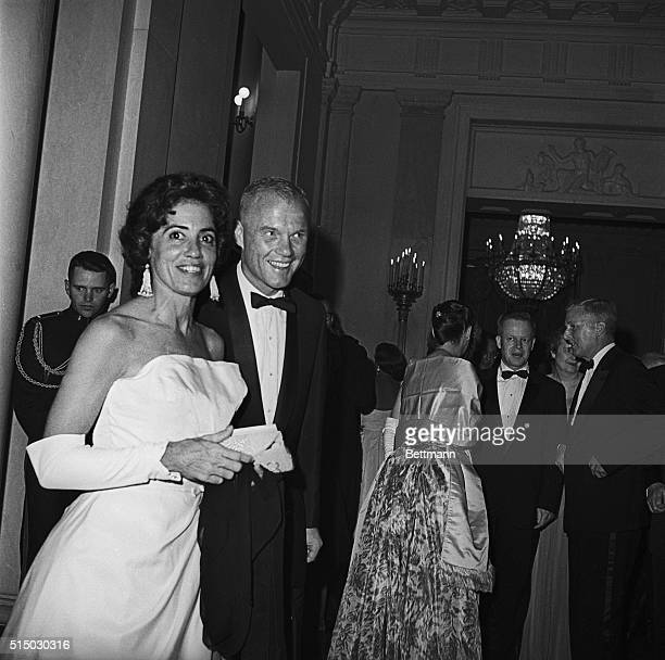 Astronaut John Glenn and his wife in formal evening wear at a party