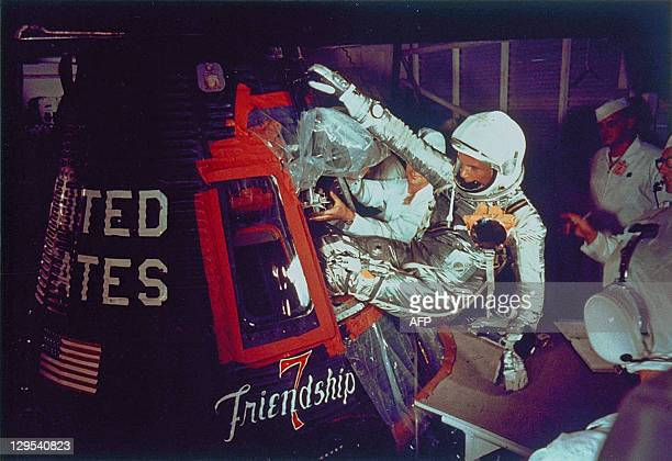 US astronaut John Glenn enters into the Mercury Frienship7 capsule in Cape Canaveral Florida on February 20 prior to the launch of the spacecraft for...