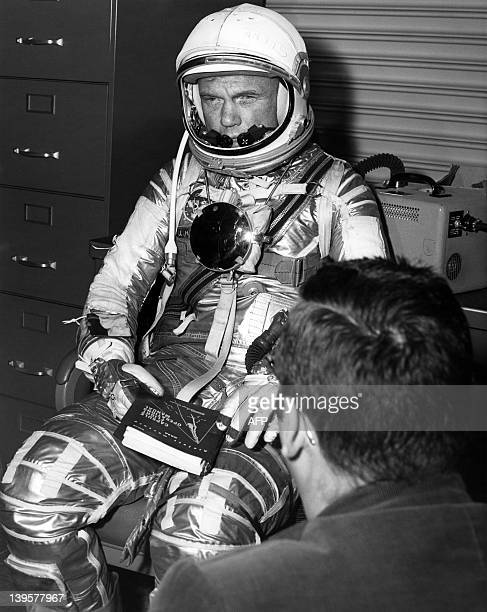US astronaut John Glenn is suited up on January 20 1962 in preparation for a simulated test during a training session before his 20 February 1962...