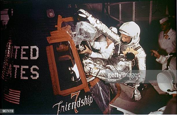 Astronaut John Glenn Jr is loaded into the Friendship 7 capsule in preparation for flight on the Mercury Titan rocket February 20 1962