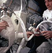 Astronaut john swigert holds a co2 scrubber made from parts found picture id576878488?s=170x170