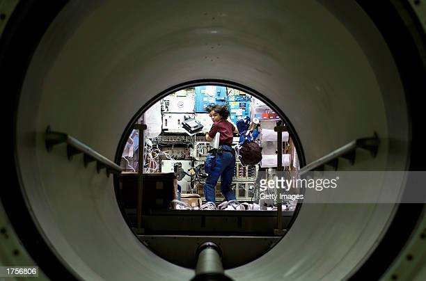Astronaut Kalpana Chawla a 41yearold flight engineer and mission specialist for Space Shuttle Columbia mission STS107 works in the SPACEHAB Research...