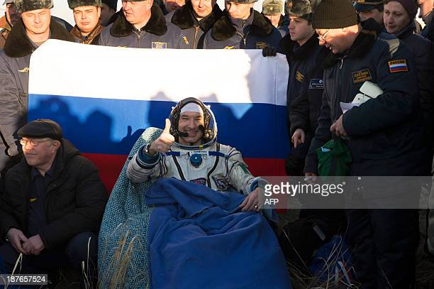 Astronaut Luca Parmitano is assisted by space programme workers upon his arrival back from space and a Soyuz TMA09M expedition on November 11 in...