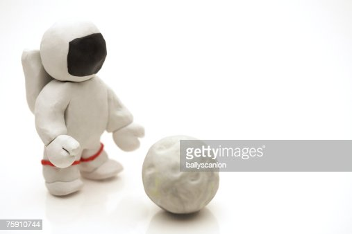 Astronaut Made Of Clay Reaching For The Moon Stock Photo