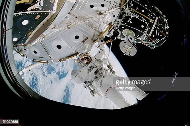 Astronaut Michael LopezAlegria Mission Specialist Hangs Onto A Handrail October 15 2000 On The USBuilt Unity Or Node 1 On The International Space...