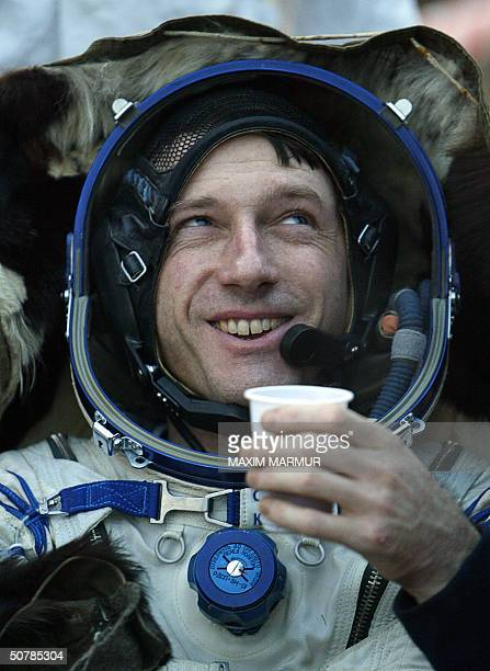 US astronaut Mike Foale smiles while drinking tea shortly after the Russian 'Soyuz TMA3' space capsule landed not far from Kazakh town of Arkalyk...