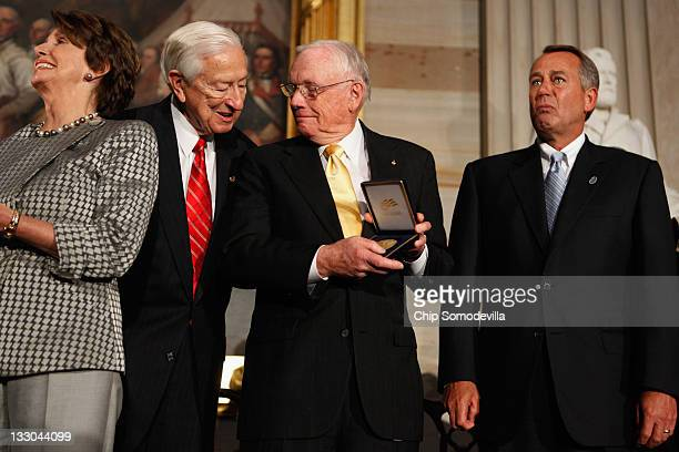 Astronaut Neil Armstrong receives the Congressional Gold Medal from Speaker of the House John Boehner House Science Space and Technology Committee...
