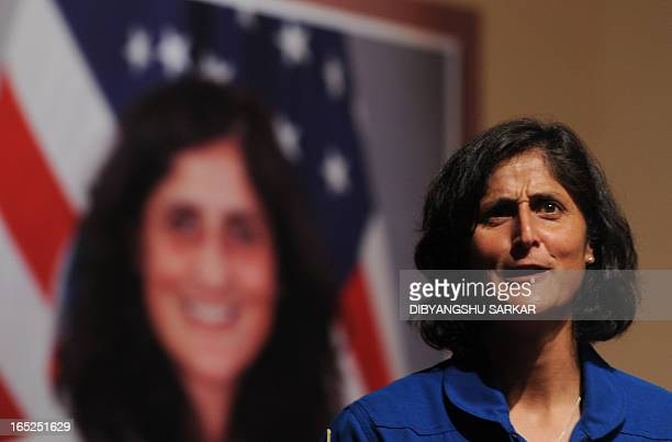 US astronaut of IndianSlovenian origin Sunita Williams gestures during an interaction with Indian school students at the Science City in Kolkata on...
