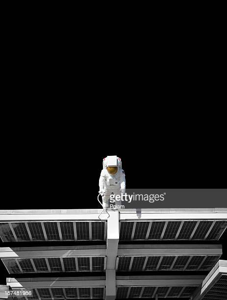 Astronaut on a solar panel floating in space