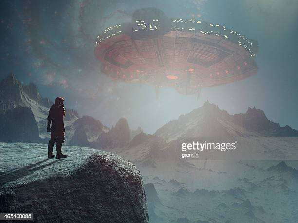 astronaut on distant planet discovering ufo - spaceship stock pictures, royalty-free photos & images