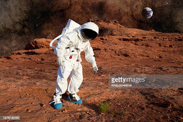 Astronaut on Mars Discovering Life