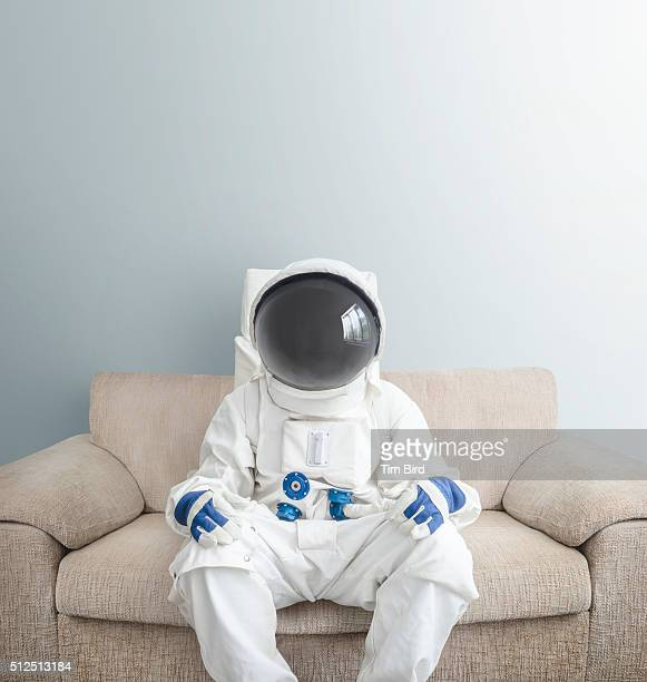 astronaut on sofa - astronaut stock-fotos und bilder