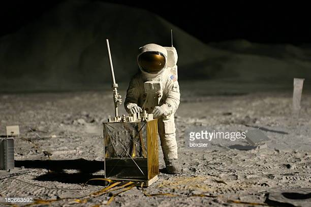 astronaut on the moon - moon surface stock pictures, royalty-free photos & images