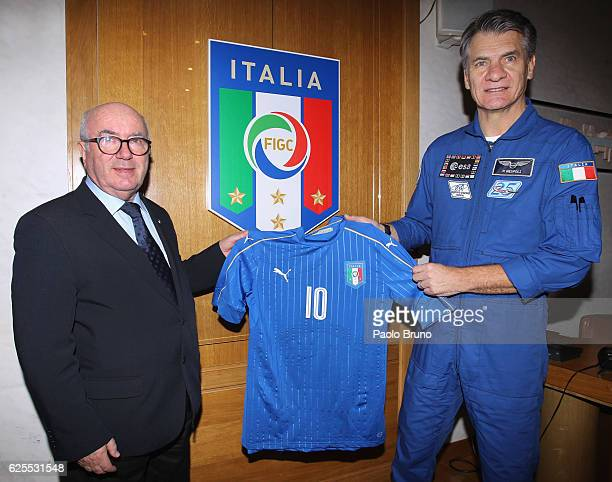 Astronaut Paolo Nespoli receives the Italy Jersey from FIGC President Carlo Tavecchio on November 24, 2016 in Rome, Italy.
