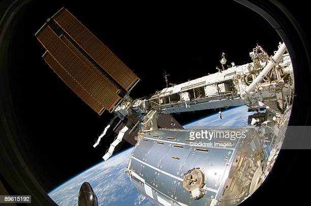 astronaut participates in extravehicular activity. - international space station stock pictures, royalty-free photos & images