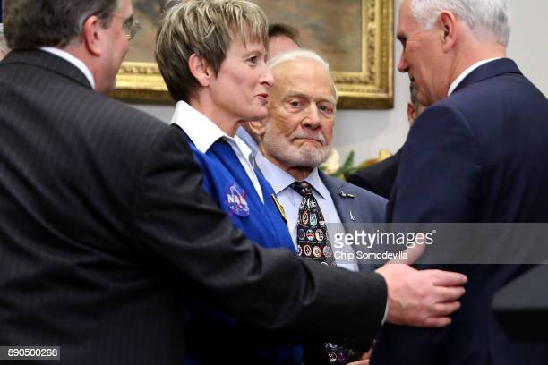OUT NASA astronaut Peggy Whitson and Apollo 11 astronaut Buzz Aldrin visit with Vice President Mike Pence after President Donald Trump signed 'Space...
