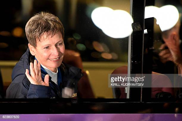 US astronaut Peggy Whitson waves from inside a bus as she leaves to board the Soyuz MS03 spacecraft at the Russianleased Baikonur cosmodrome on...