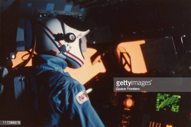 NASA astronaut Robert L Crippen commander of the STS41G crew in the cockpit of the 'Challenger' space shuttle during the reentry phase of his...