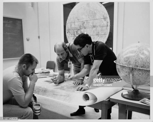Astronaut Ronald E Evans the Command Module Pilot of NASA's Apollo 17 lunar landing mission is briefed on geology by Farouk ElBaz Supervisor of Lunar...