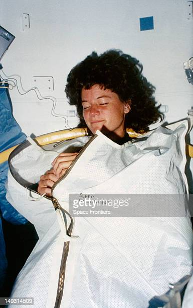 NASA astronaut Sally Ride in her sleep restraint during the STS7 mission on the space shuttle Challenger June 1983 On this mission she became the...