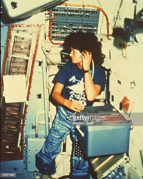 Astronaut Sally Ride the first American woman in space inside the space shuttle Challenger c 1983