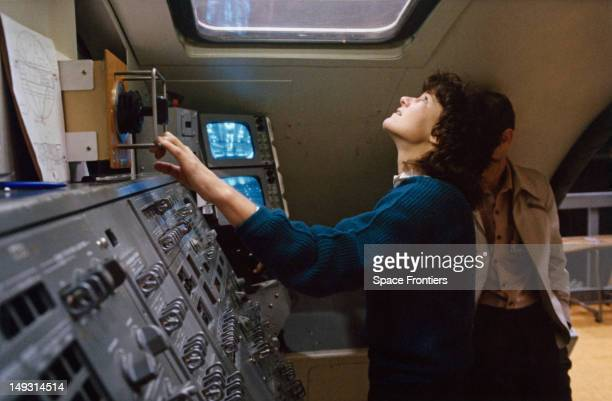NASA astronaut Sally Ride trains in the Manipulator Development Facility of the mockup and integration laboratory at the Johnson Space Center Houston...