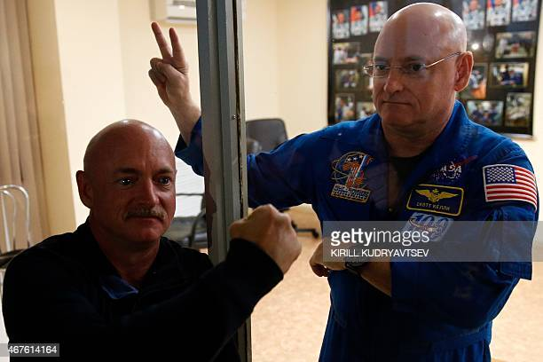 US astronaut Scott Kelly and his brother Mark pose after a press conference at the Russianleased Baikonur cosmodrome on March 26 2015 Russia's Soyuz...